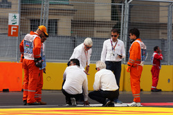 Charlie Whiting, FIA Delegate and Herbie Blash, FIA Delegate inspect the circuit after GP2 qualifyin