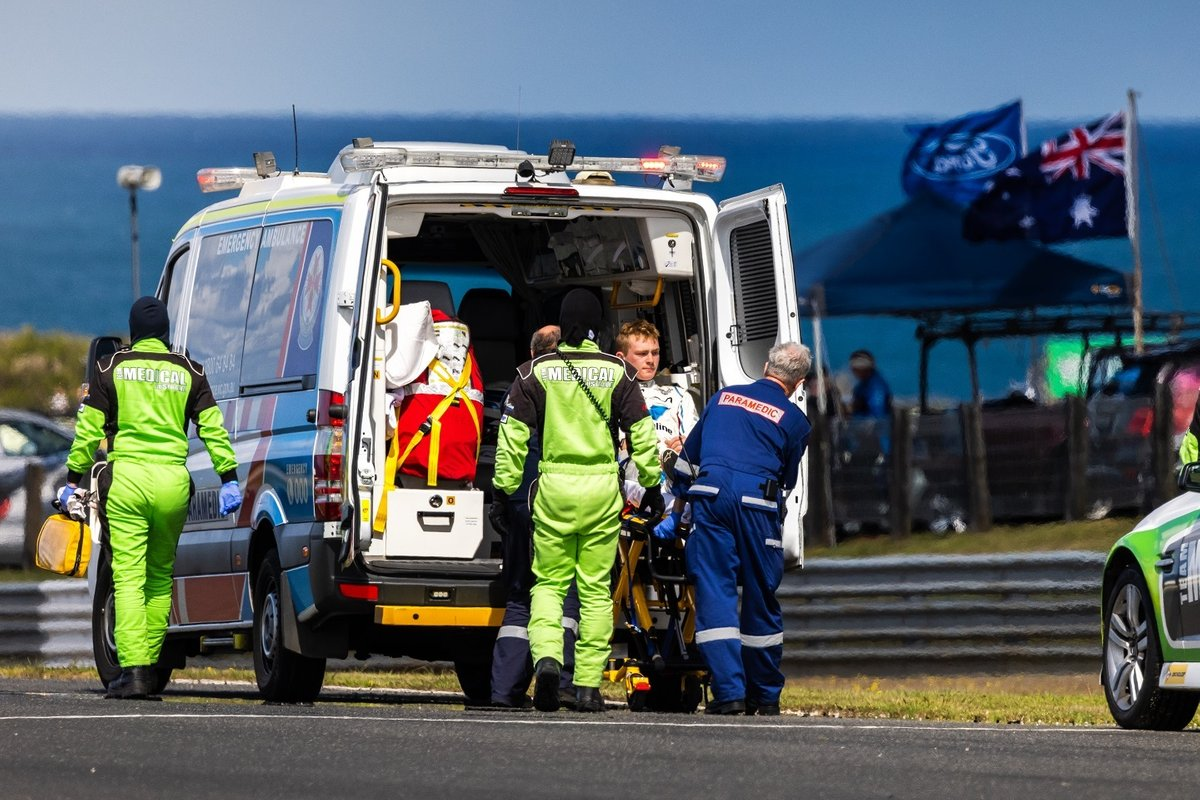 Nathan Herne is taken to hospital in an ambulance