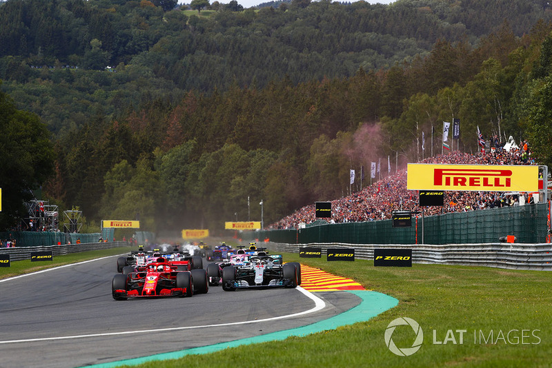 Sebastian Vettel, Ferrari SF71H, leads Lewis Hamilton, Mercedes AMG F1 W09, Sergio Perez, Racing Point Force India VJM11, and Esteban Ocon, Racing Point Force India VJM11, at the start