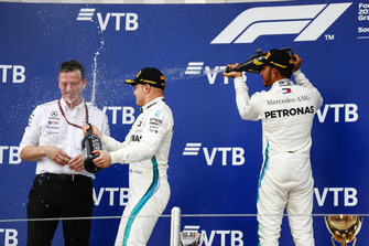 Race winner Lewis Hamilton, Mercedes AMG F1, sprays Champagne at second place Valtteri Bottas, Mercedes AMG F1, and James Allison, Technical Director, Mercedes AMG