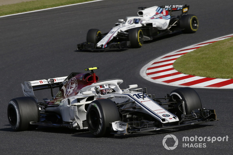 Charles Leclerc, Sauber C37 leads Lance Stroll, Williams FW41