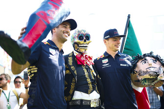 Daniel Ricciardo, Red Bull Racing, and Max Verstappen, Red Bull Racing, pose with a skeleton