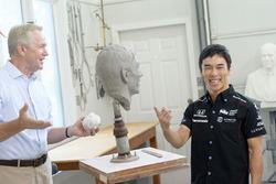 Takuma Sato with the Borg-Warner Trophy bust