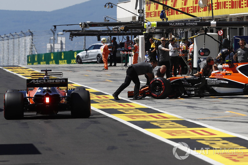 Fernando Alonso, McLaren MCL32, heads out as Stoffel Vandoorne, McLaren MCL32, is returned to the garage