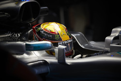 Lewis Hamilton, Mercedes AMG F1 W08, sits in the cockpit of his car in the garage