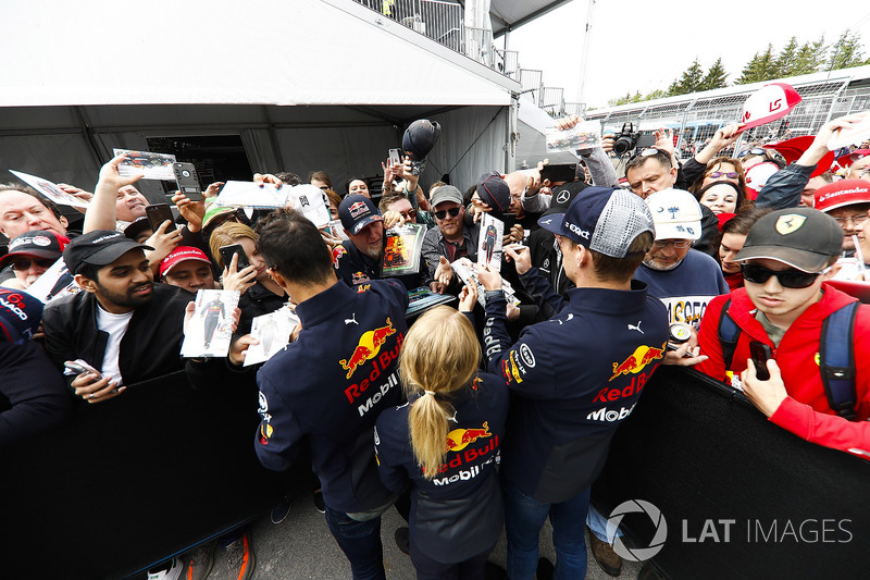 Daniel Ricciardo, Red Bull Racing, and Max Verstappen, Red Bull Racing, sign autographs for fans