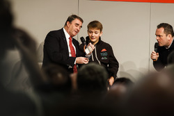 Nigel Mansell talks to Henry Hope-Frost, and performs a magic trick, with Billy Monger on the Autosport Stage