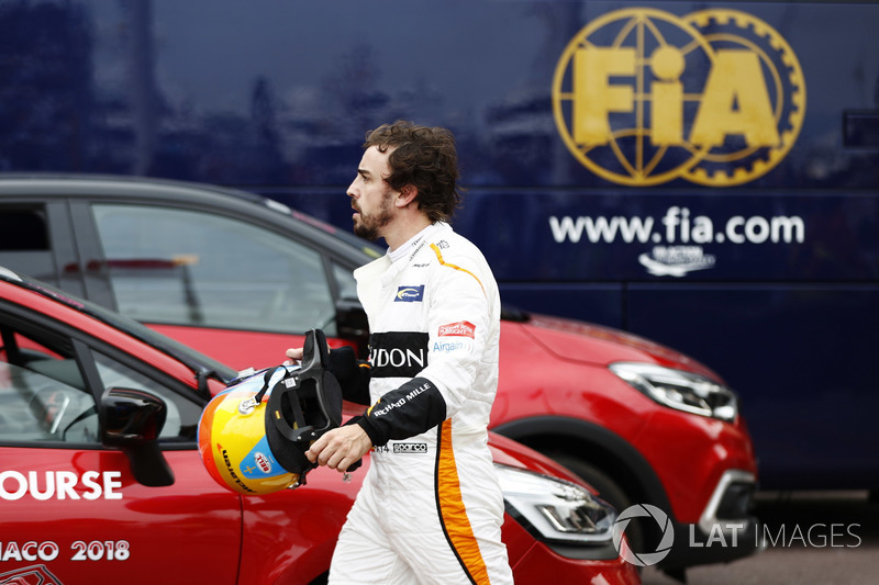 Fernando Alonso, McLaren, retires from the race