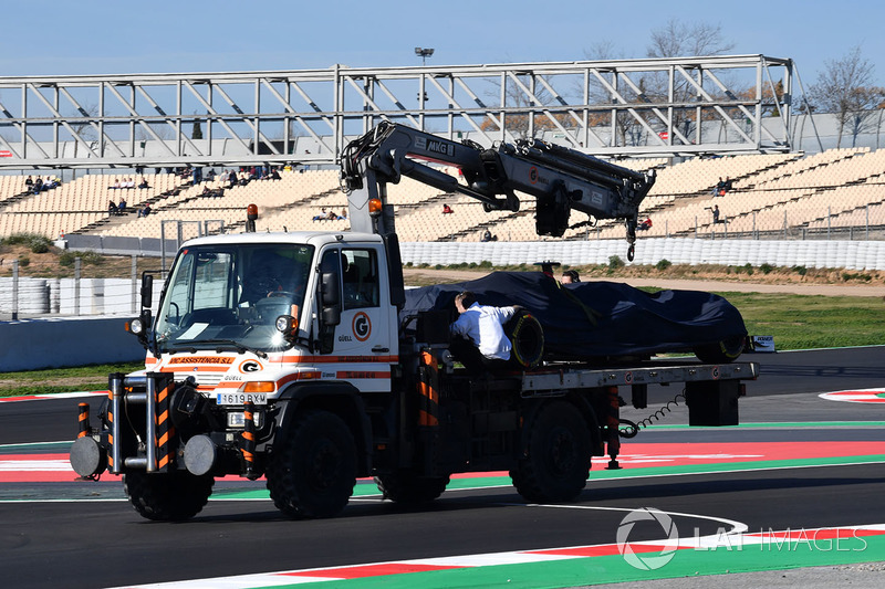 The car of Charles Leclerc, Alfa Romeo Sauber C37 is recovered to the pits