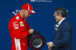 Sebastian Vettel, Ferrari, signs his pole position award