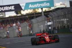 Sebastian Vettel, Ferrari SF71H, takes the chequered flag for victory