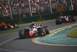 Kevin Magnussen, Haas F1 Team VF-18 Ferrari, leads Romain Grosjean, Haas F1 Team VF-18 Ferrari, and Daniel Ricciardo, Red Bull Racing RB14 Tag Heuer