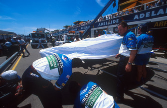 The car of Michael Schumacher, Benetton B194 Ford is brought back to the pits after its collision