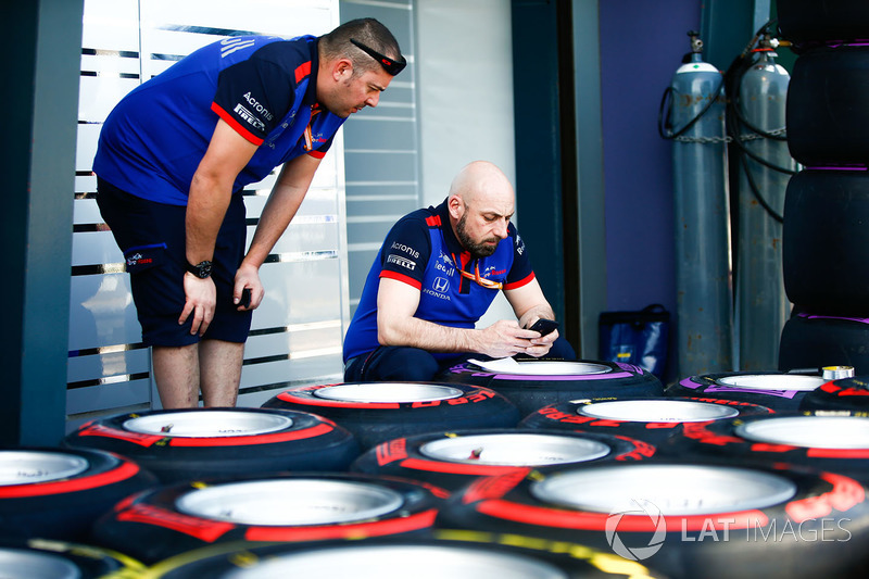Scuderia Toro Rosso engineers tag the Pirelli soft and supersoft tyres in the pitlane