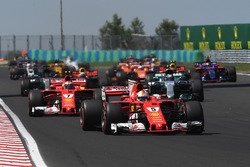 Sebastian Vettel, Ferrari SF70-H leads at the start of the race