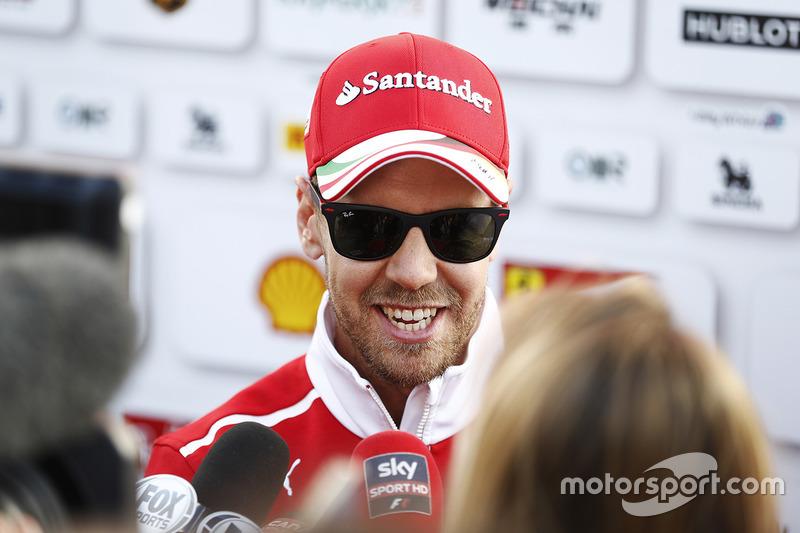 Sebastian Vettel, Ferrari, speaks to the media