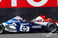 Schumacher races Montoya for title