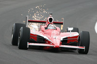 Dixon and Wheldon lead at rainy Indy