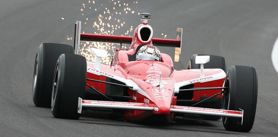 Dixon and Wheldon lead at rainy Indy