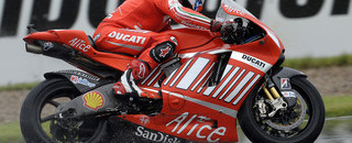 MotoGP Stoner dominates wet British GP qualifying