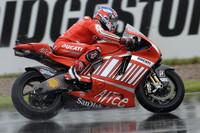 Stoner dominates wet British GP qualifying