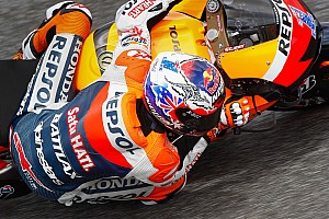 MotoGP Stoner takes his first pole of 2012 at Estoril