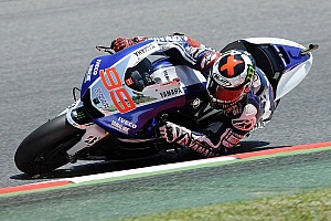 MotoGP Race report Lorenzo triumphs in front of home fans at crash fest Catalunya