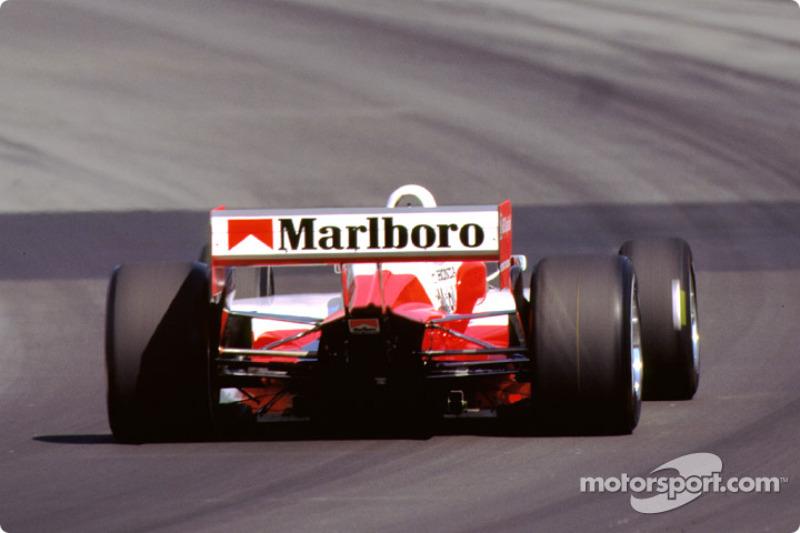 Gil de Ferran in turn two