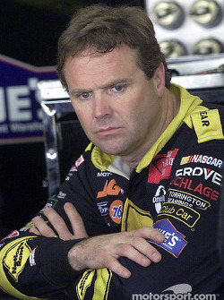 Mike Wallace waits in the garage area