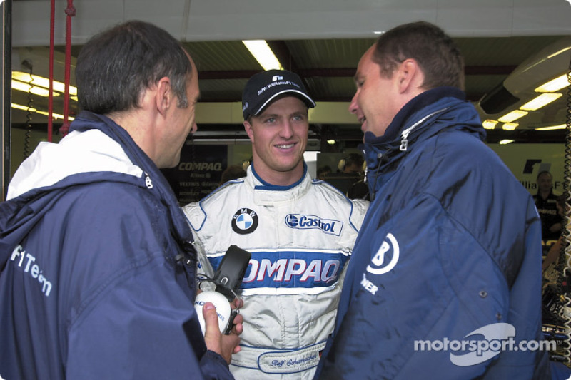 Ralf Schumacher discussing with Gerhard Berger