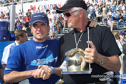 An emotional moment: Alex Tagliani receiving the Greg Moore Pole Award from Rick Moore