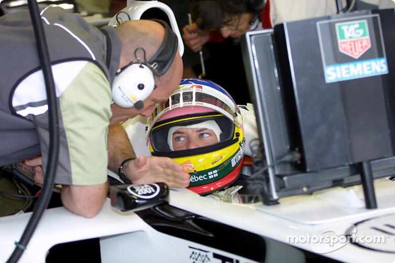 Jacques Villeneuve discussing with Jock Clear