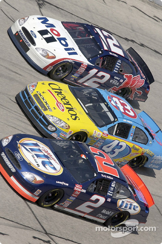 The Wallace brothers Rusty and Mike sandwiching John Andretti