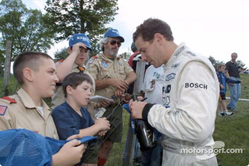 Butch Leitzinger signs autographs for fans at Lime Rock Park
