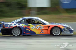 The #44 Zippo Mustang Saleen races down a straightaway