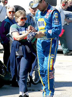Michael Waltrip signing an autograph