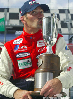 Max Papis kisses his trophy in Victory lane after winning the Rolex 24 At Daytona