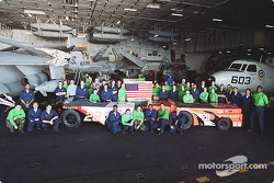 Postcard from the USS Theodore Roosevelt: aviation support equipment people have really shown their colors as NASCAR fans: they've painted two of the aircraft towing tractors to match up with Tony Stewart and Ricky Rudd's NASCAR racecars