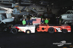 Postcard from the USS Theodore Roosevelt: the men who worked on the tractors;  Chief Petty Officer Todd Corsi, Petty Officer 3rd Class Joshua Green, Petty Officer 2nd Class Scott Levenduski,  Petty Officer 3rd Class Dale Bunnell, and Airman Carlos Bernalo