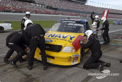 The Roush Racing crew work on the damaged Ford F150 of Jon Wood