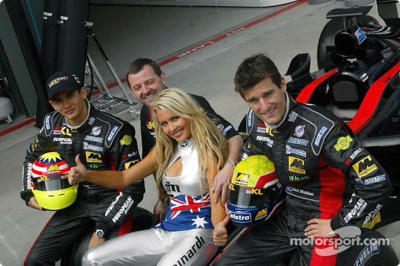 Sarah Jane posing with Alex Yoong, Mark Webber and Paul Stoddart