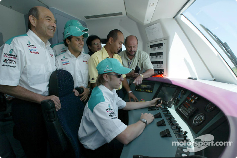 Visit at the KLIA Ekspres trainset: Peter Sauber, Felipe Massa and Nick Heidfeld