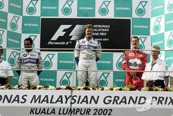 The podium: race winner Ralf Schumacher, Juan Pablo Montoya and Michael Schumacher