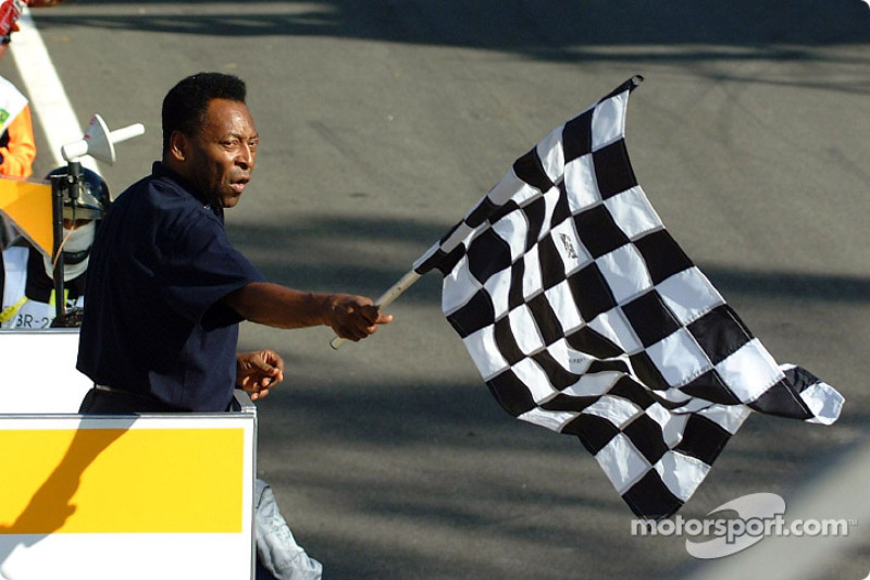 Pelé giving the checkered flag