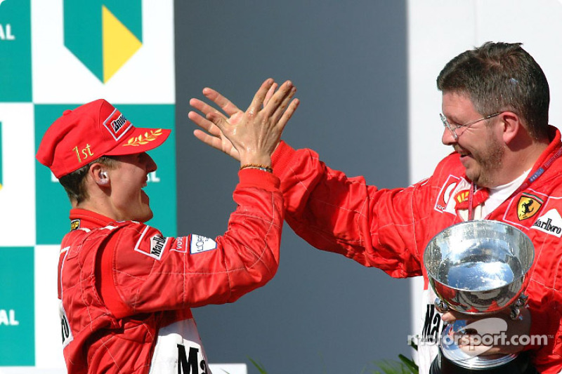 Race winner Michael Schumacher and Ross Brawn