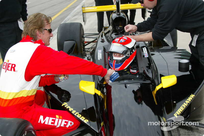 Arie Luyendyk discussing with Johnny Herbert