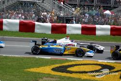 First corner: Jarno Trulli and Jacques Villeneuve