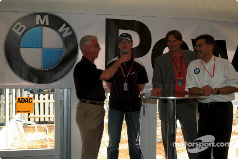 Ralf Schumacher and BMW Motorsport Director Dr. Mario Theisse with ADAC sports director Hermann Tomc