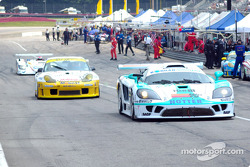 Cars heading out on the track