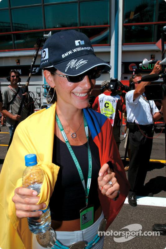 Connie celebrating her boyfriend Juan Pablo's pole position